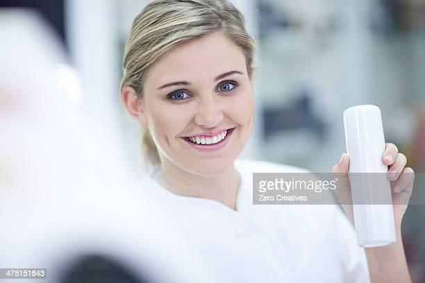 Shop assistant showing make up