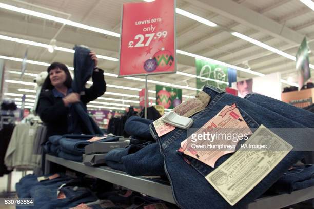 A shop assistant with Levi's jeans at the Kingston Park Tesco store in Newcastle The supermarket chain lost its fight to sell cutprice designer goods...