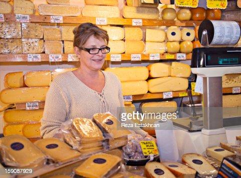 Shop assitant smiles at customer : Stock Photo