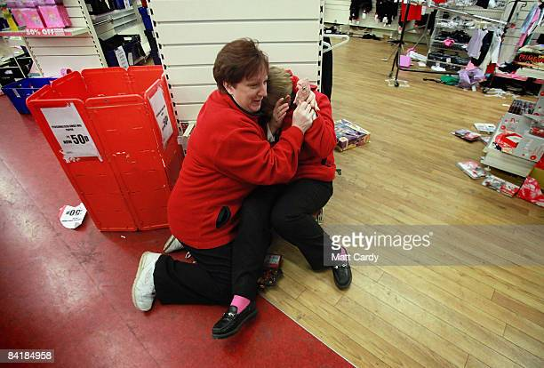 Shop employees comfort each other in the Stroud branch of Woolworths after it closed its doors for the final time on January 6 in Stroud England The...