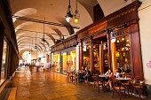 Shop facades in the arcades of Piazza Castello.