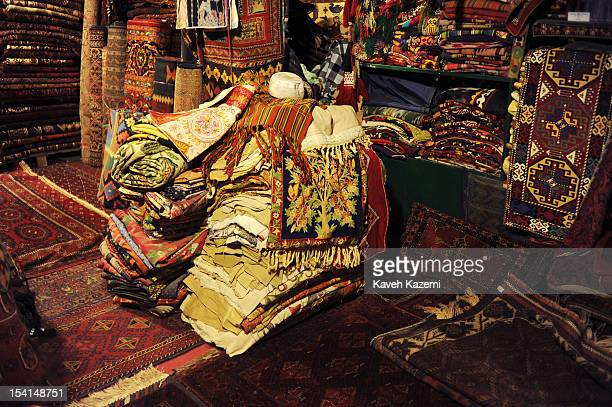 A shop filled with Afghan carpets and rugs located in Chicken Street on October 17 2011 in Kabul Afghanistan Chicken Street has been a focus for...