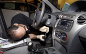 Shop foreman John Chapman performs a service recall on a General Motors Co 2005 Saturn Ion at Liberty Chevrolet in New Hudson Michigan US on Friday...