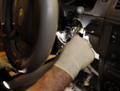 Shop foreman John Chapman performs the service recall on a General Motors Co 2005 Chevrolet Cobalt at Liberty Chevrolet in New Hudson Michigan US on...