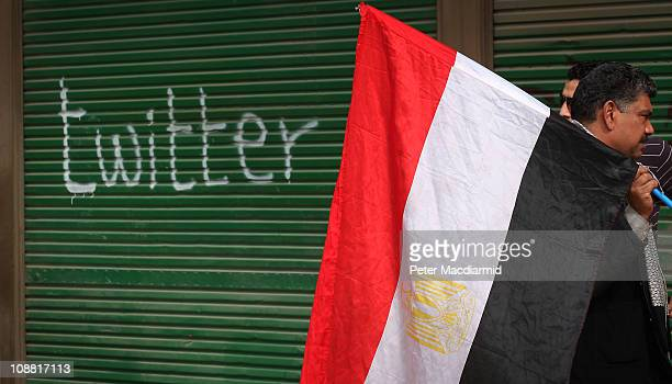 A shop in Tahrir Square is spray painted with the word Twitter after the government shut off internet access on February 4 2011 in Cairo Egypt...