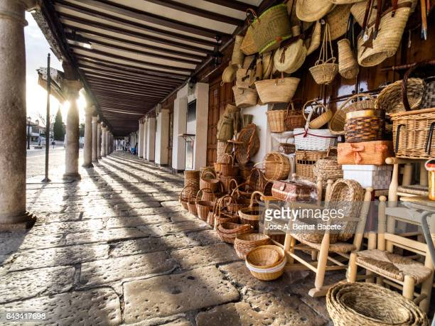 Shop in the street of products of crafts in wicker in the ancient square of  Almagro, Ciudad Real, Spain.