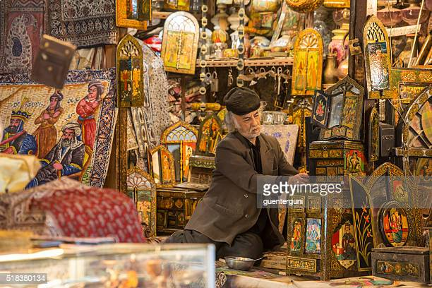 Shop owner in the Imperial Bazaar of Isfahan, Iran