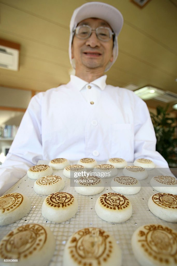 Shop owner Koichi Inoue displays 'Obama manju' in support of the Democratic presidential candidate US Sen Barack Obama at Japanese traditional sweet...