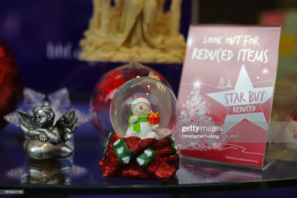 A shop selling festive decorations entices customers with discounts on December 4, 2012 in Rotherham, United Kingdom. Retailers across Britain are struggling as people wait for bigger discounts before spending for the Christmas period. The British Retail Consortium (BRC) said that it's members were in a 'state of nervousness' in the last weeks of the festive period.
