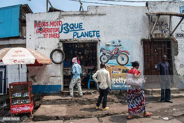 A shop selling motorbike spare parts generators and other items lies in a Goma district rebuilt on a layer of lava resulting from the eruption in...