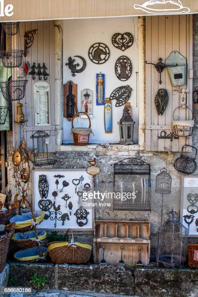 A shop selling rustic decorative objects including ironware and baskets