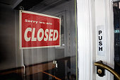 Shop front door with sign 'Sorry We're Closed'