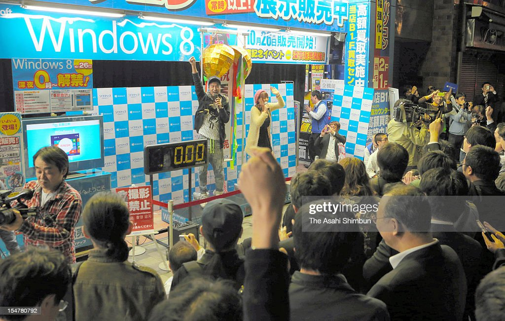 Shop staffs and customers count down during the Microsoft Windows 8 launching event on october 26, 2012 in Tokyo, Japan.
