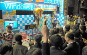 Shop staffs and customers count down during the Microsoft Windows 8 launching event on october 26 2012 in Tokyo Japan