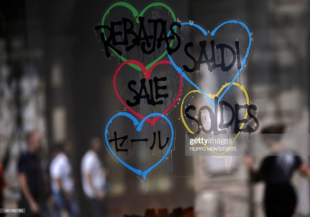 A shop window advertising sale in different languages on July 6, 2014 in downtown Rome, as Italian retailers started their summer sales.