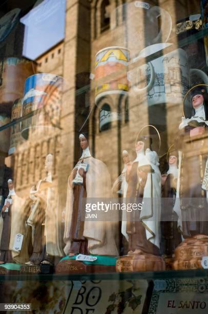 Shop window with images of Santa Teresa opposite the Cathedral Avila Autonomous Community of CastileLeon Spain April 2008
