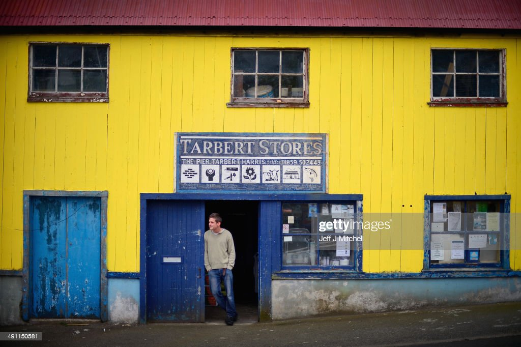 Shop worker David Prentice, stands in the doorway of The Tarbert Stores on May 15, 2014 in Harris, Scotland. The Isles of Lewis and Harris lie in the Outer Hebrides and make up the largest island in Scotland and stretch for 100 miles. The Isles of Harris and Lewis will vote along with the rest of Scotland in the referendum on whether Scotland should be an independent country on September 18, 2014. Harris and Lewis's economy is a mix of traditional businesses like fishing, weaving and farming, with more recent influence of tourism, the popularity of Harris and Lewis has grown steadily over recent years.