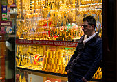 A shop worker waits for customers outside a gold jewelry store inside the Grand Bazaar shopping district of Istanbul Turkey on Thursday Feb 27 2014...