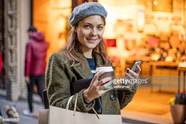 Shopaholic woman standing outside retail store