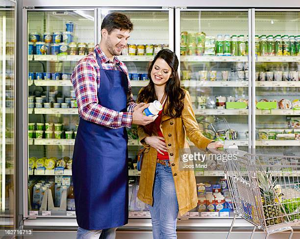 shopassistant explaining product to young woman