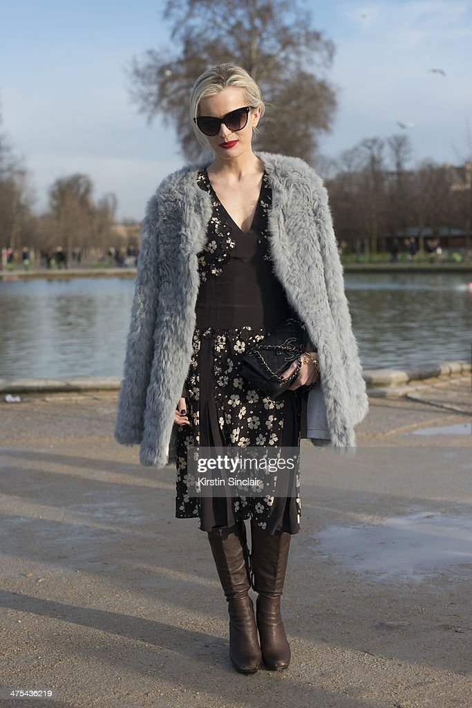 Shopbop Style Director Eleanor Strauss wears a Chanel bag, Adrienne Landau coat, Bottega Veneta dress, Miu Miu boots and Stella McCartney bracelet on day 3 of Paris Collections: Women on February 27, 2014 in Paris, France.