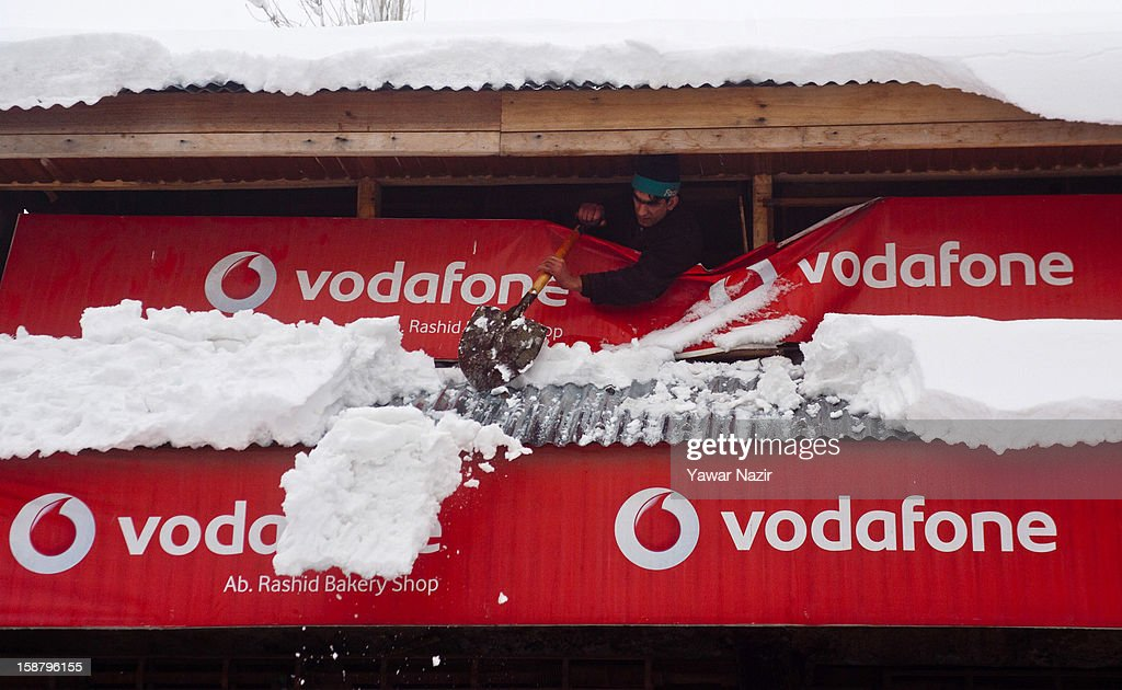 A shopkeeper clears the snow from his shop during a snowfall on December 29, 2012 in Gulmarg, 54 km (35 miles) to the west of Srinagar, the summer capital of Indian-administered Kashmir, India. With the second round of heavy snowfall in Kashmir valley, skiers from around the globe have descended on the ski resort of Gulmarg, known for long-run skiing, snow-boarding, heli-skiing and steep mountains. Gulmarg is located less than six miles from the ceasefire line or Line of Control (LoC) that divides Kashmir between India and Pakistan. As a sense of normalcy has started to return to this strife-torn region, various foreign governments, including the United Kingdom, have lifted the travel advisory to its citizens traveling to Kashmir, raising the hopes of the local tourism industry, officials said.