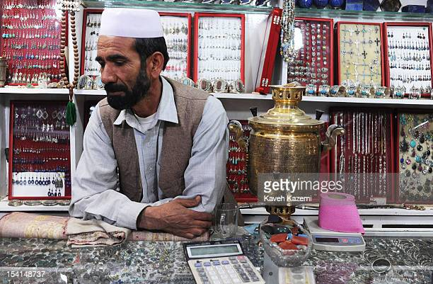 A shopkeeper dealing in gems and antiques seen in his shop in Chicken Street on October 17 2011 in Kabul Afghanistan Chicken Street has been a focus...