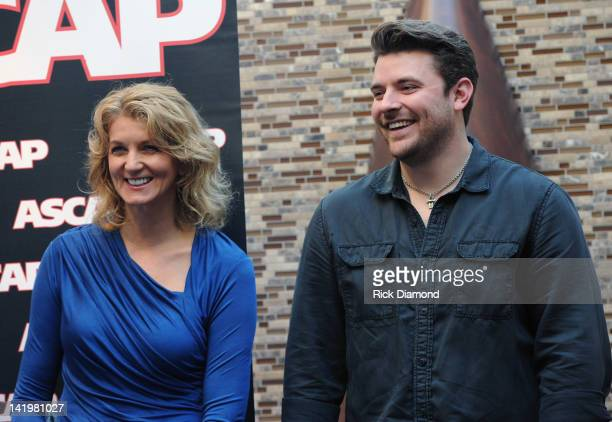 ShopKeeper Management's Marion Kraft and Singer/Songwriter Chris Young attend the Chris Young party at the CMA Office on March 27 2012 in Nashville...