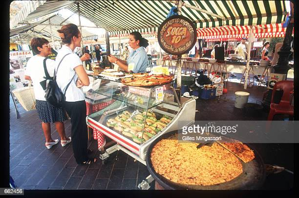 A shopkeeper serves La Socca which is a local specialty October 15 1997 in Nice France October in the area surrounding the French Riviera near Nice...