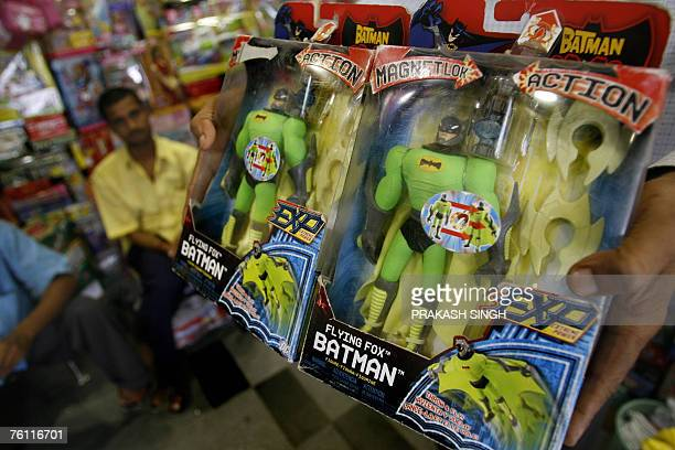 A shopkeeper shows a Batman series toy 'J5115 Magna Fight Armor Flying Fox batman' made by US toy giant Mattel in New Delhi 16 August 2007 In a...