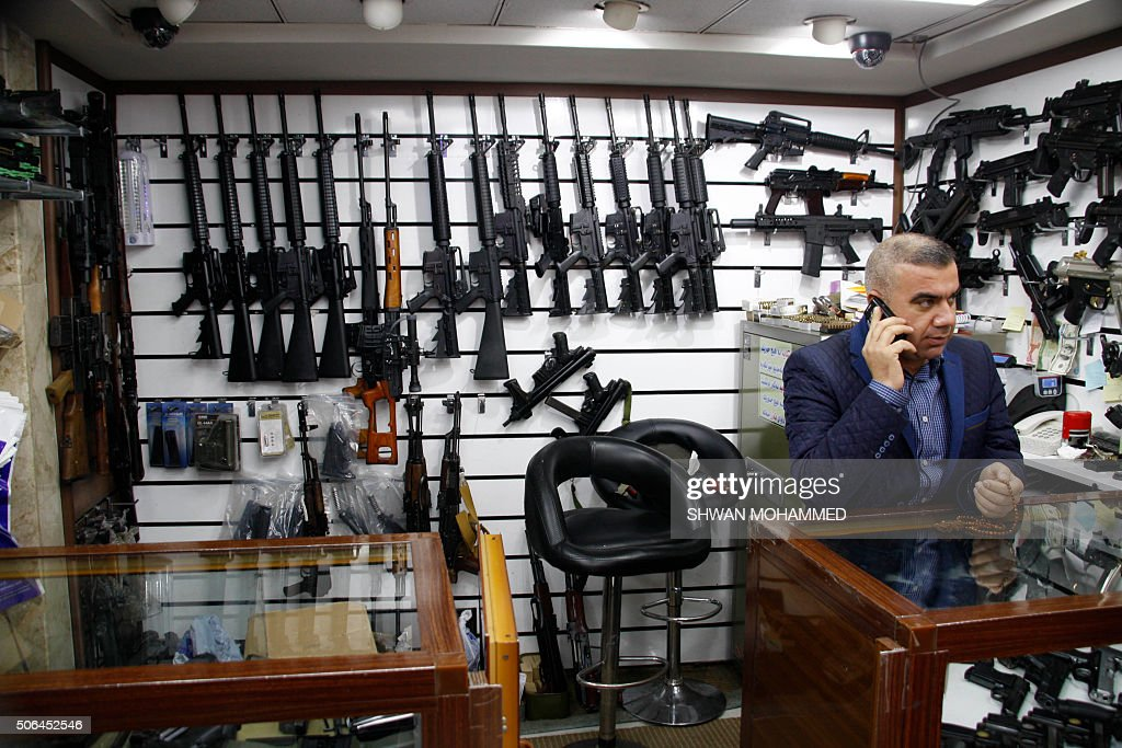 A shopkeeper speaks on the phone is his store where he sells and purchases weapons in the Iraqi city of Sulaimaniyah 330 kilometres north of Baghdad...