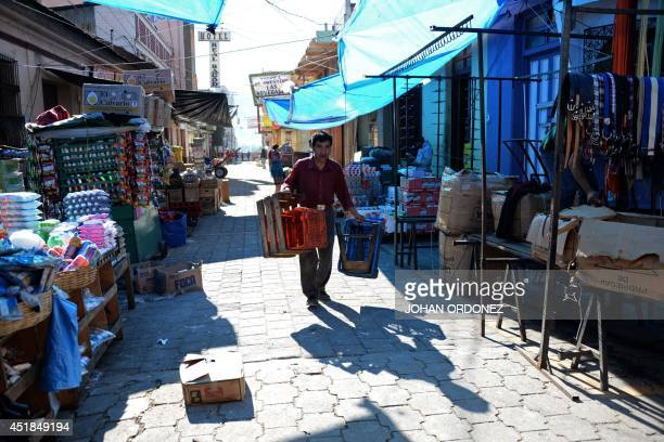 A shopkeeper walks in San Pedro Sacatepequez municipality in San Marcos departament 240 km of Guatemala City on July 8 2014 a day after an earthquake...