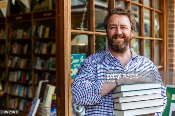 Shopkeeper Welcoming Customers to his Traditional English Bookshop