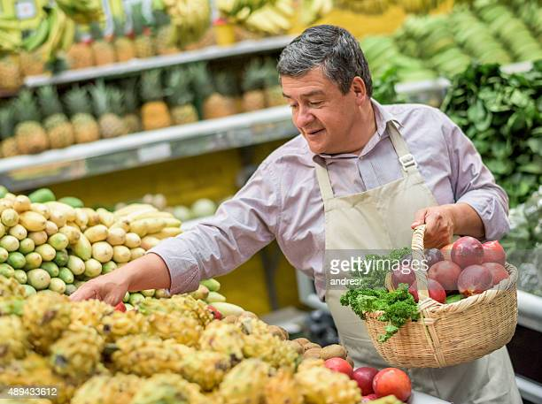 Shopkeeper working at a food market