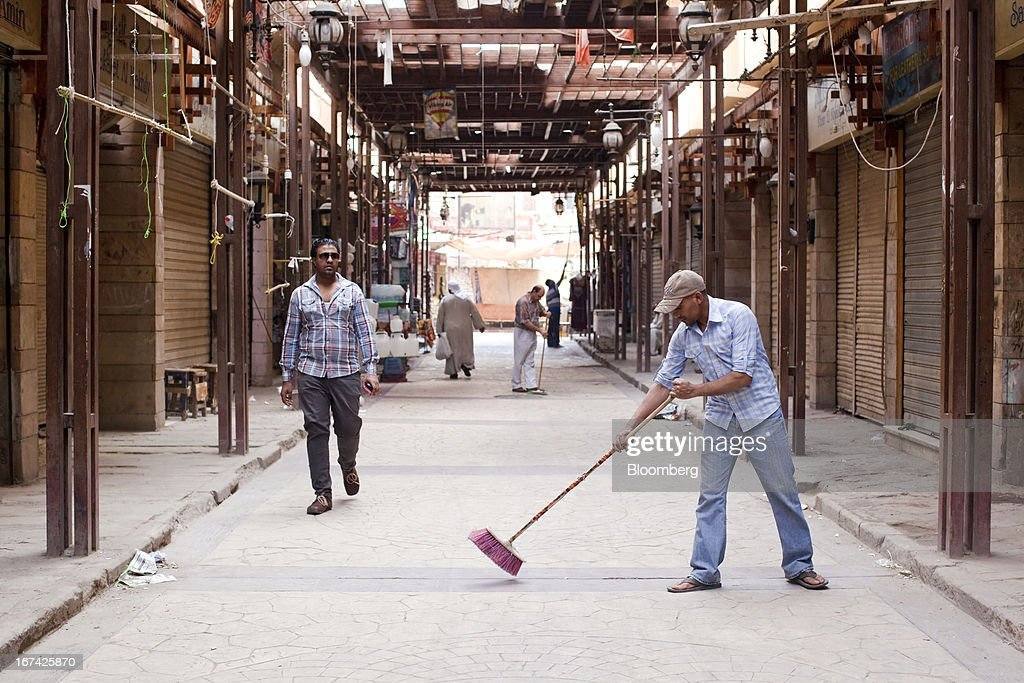 Shopkeepers use brooms to sweep walkways in an empty souk in Luxor, Egypt, on Thursday, April 25, 2013. Egypt ranked last in terms of security and safety on the World Economic Forum's 2013 Travel and Tourism Competitiveness Index. Photographer: Shawn Baldwin/Bloomberg via Getty Images