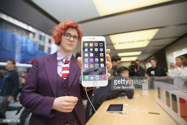 Shopper Alice Clarke shows off the new iPhone 6 as crowds wait in anticipation for the release of the iPhone 6 at Apple Store on September 19 2014 in...