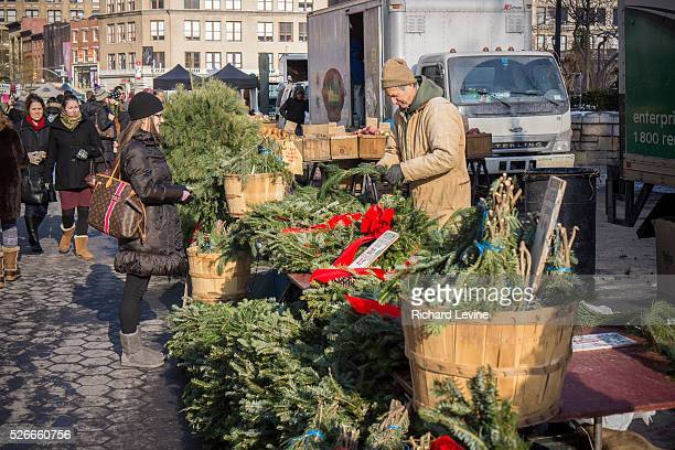A shopper at a stand at the Union Square Greenmarket in New York shops for Christmas decorations Because of high demand and short supply prices of...