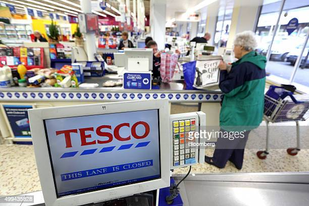 A shopper bags her items at a checkout at the Tesco Basildon Pitsea Extra supermarket operated by Tesco Plc in Basildon UK on Tuesday Dec 1 2015 Many...