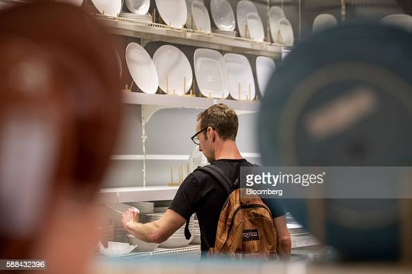 A shopper browses a bowl in the kitchen department of an IKEA AB store in Emeryville California US on Tuesday Aug 9 2016 The US Census Bureau is...
