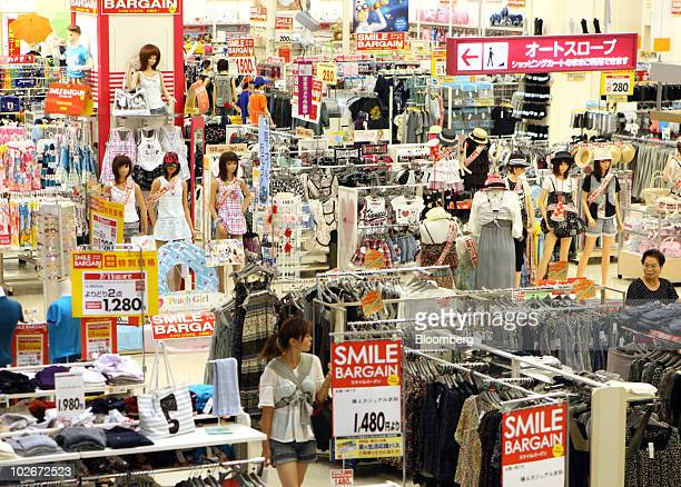 A shopper browses an Aeon Co shopping center in Tokyo Japan on Wednesday July 7 2010 Aeon Co will book a gain of 181billion yen in the fiscal year...