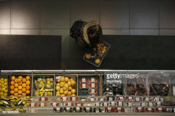 A shopper browses fresh fruit and vegetables in the foodhall inside a branch of Marks Spencer Group Plc in London UK on Tuesday Dec 5 2017 Brexit...