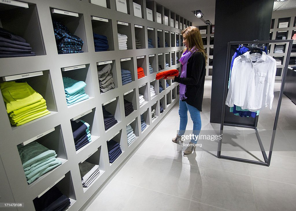 A shopper browses items on sale inside the women's fashion outlet at Harrods luxury department store in London, U.K., Monday, June 24, 2013. Harrods, which has more than 1 million square feet (90,000 square meters) of selling space, isn't concerned about the outlook for spending on luxury goods, Harrods Managing Director Michael Ward said. Photographer: Jason Alden/Bloomberg via Getty Images