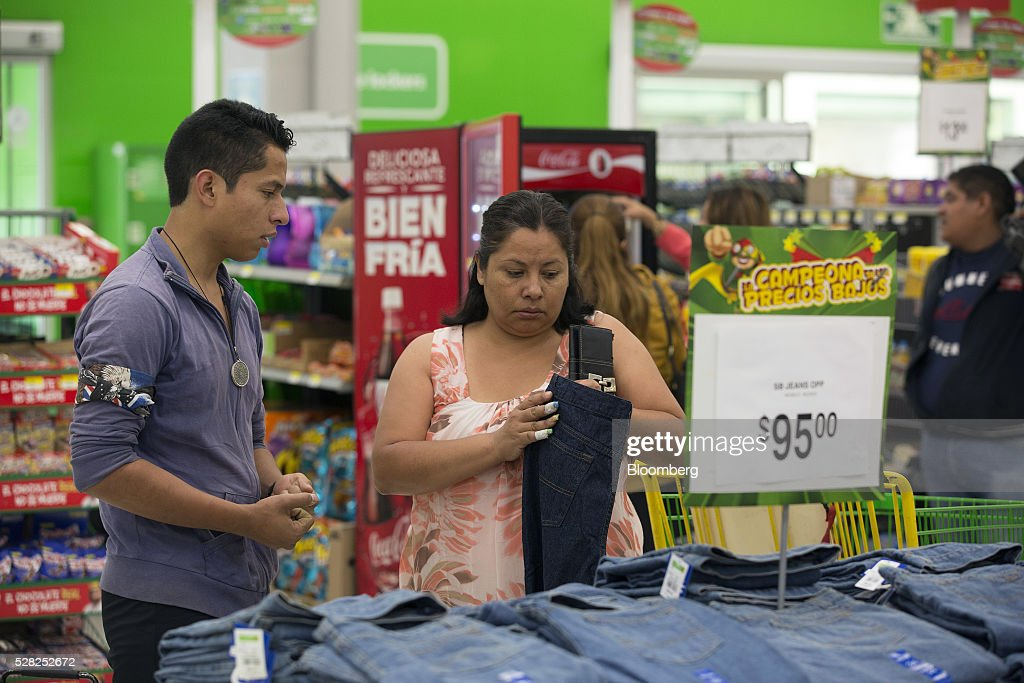 A shopper browses jeans displayed for sale at a Bodega Aurrera store, the discount chain owned by Wal-Mart Stores Inc., in Naucalpan de Juarez, Mexico, on Wednesday, May 4, 2016. Wal-Mart de Mexico SAB reported first-quarter results last week that beat analysts estimates, the most recent sign of growth for Mexican companies this earnings season. Photographer: Susana Gonzalez/Bloomberg via Getty Images