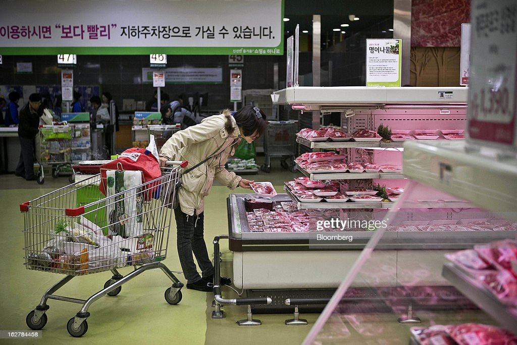 A shopper browses meat at Hanaro Mart in Seoul, South Korea, on Tuesday, Feb. 26, 2013. South Korean consumer confidence remained at its highest level since May as gains in the won drove down the prices of imported goods. Photographer: Jean Chung/Bloomberg via Getty Images