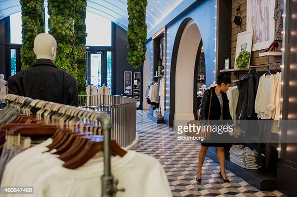 A shopper browses merchandise at a Banana Republic LLC store in San Francisco California US on Thursday Dec 18 2014 Apparel store traffic improved...