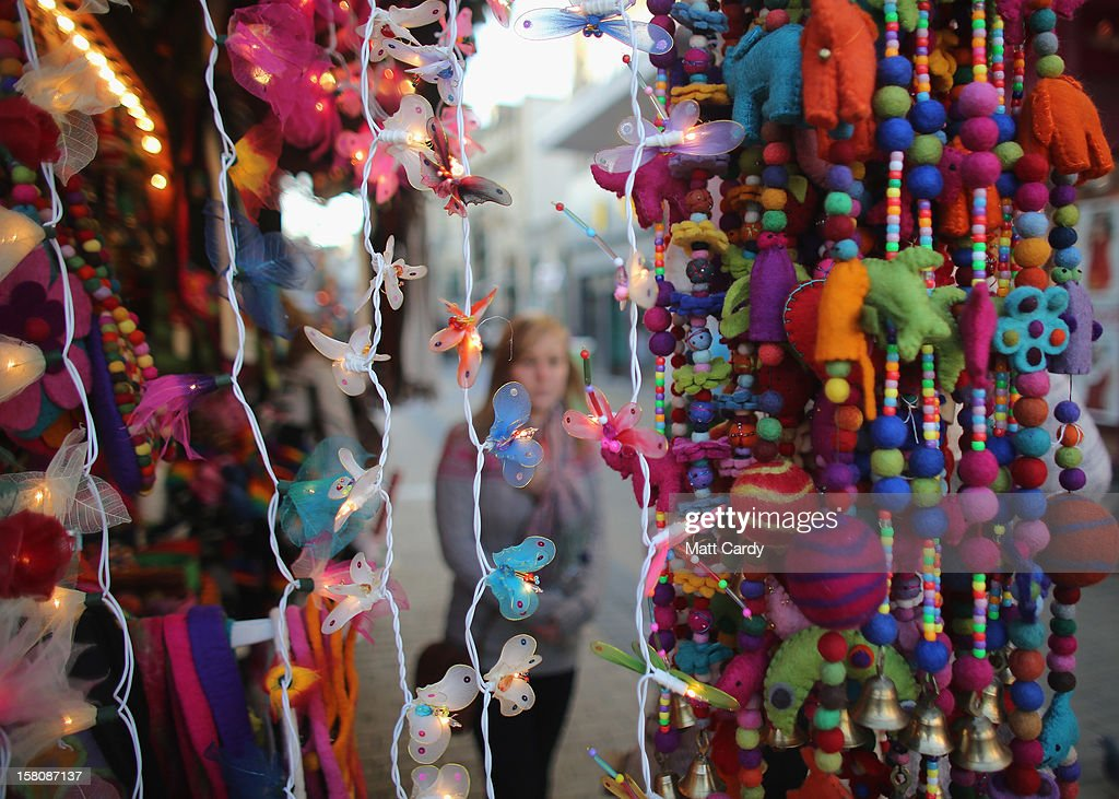 A shopper browses merchandise at a stall in a Christmas market on December 10, 2012 in Bristol, England. With internet shopping still on the rise, many traditional retailers claim this Christmas could be the one that will determine the future of the high street.