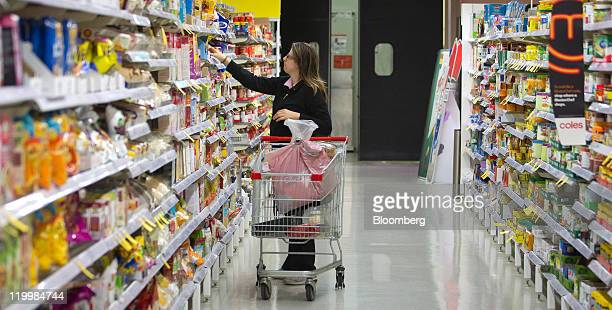 A shopper browses products at a Wesfarmers Ltd Coles supermarket in Sydney Australia on Thursday July 28 2011 Wesfarmers Ltd Australia's...