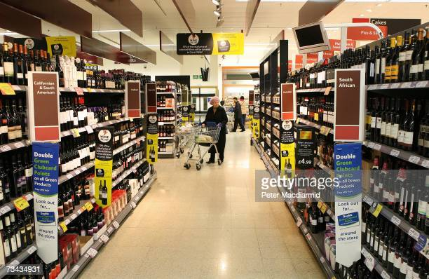 A shopper browses the alcohol section at a Tesco store on February 27 2007 in London England Tesco is the the UK's biggest supermarket chain with a...