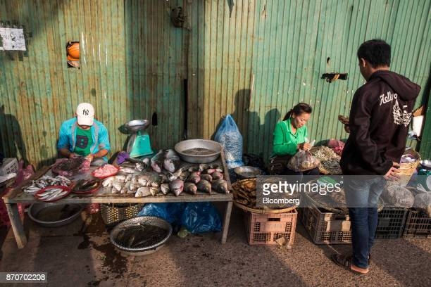 A shopper buys dried fish from a vendor at a morning market in Vientiane Laos on Thursday Nov 2 2017 Located in the Mekong region Southeast Asia's...