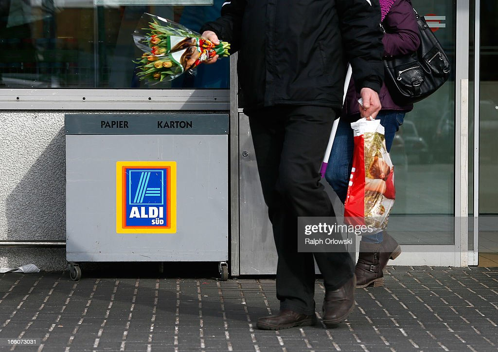 A shopper carries a bag of groceries from an Aldi store on April 8, 2013 in Ruesselsheim near Frankfurt, Germany. Aldi, which today is among the world's most successful discount grocery store chains, will soon mark its 100th anniversary and traces its history back to Karl Albrecht, who began selling baked goods in Essen on April 10, 1913 and founded the Aldi name by shortening the phrase Albrecht Discount. His sons Karl Jr. and Theo expanded the chain dramatically, creating 300 stores by 1960 divided between northern and southern Germany, with Aldi Nord and Aldi Sued, respectively. Today the two chains have approximately 4,300 stores nationwide and have also expanded into other countries across Europe and the USA. Aldi Nord operates in the USA under the name Trader Joe's.